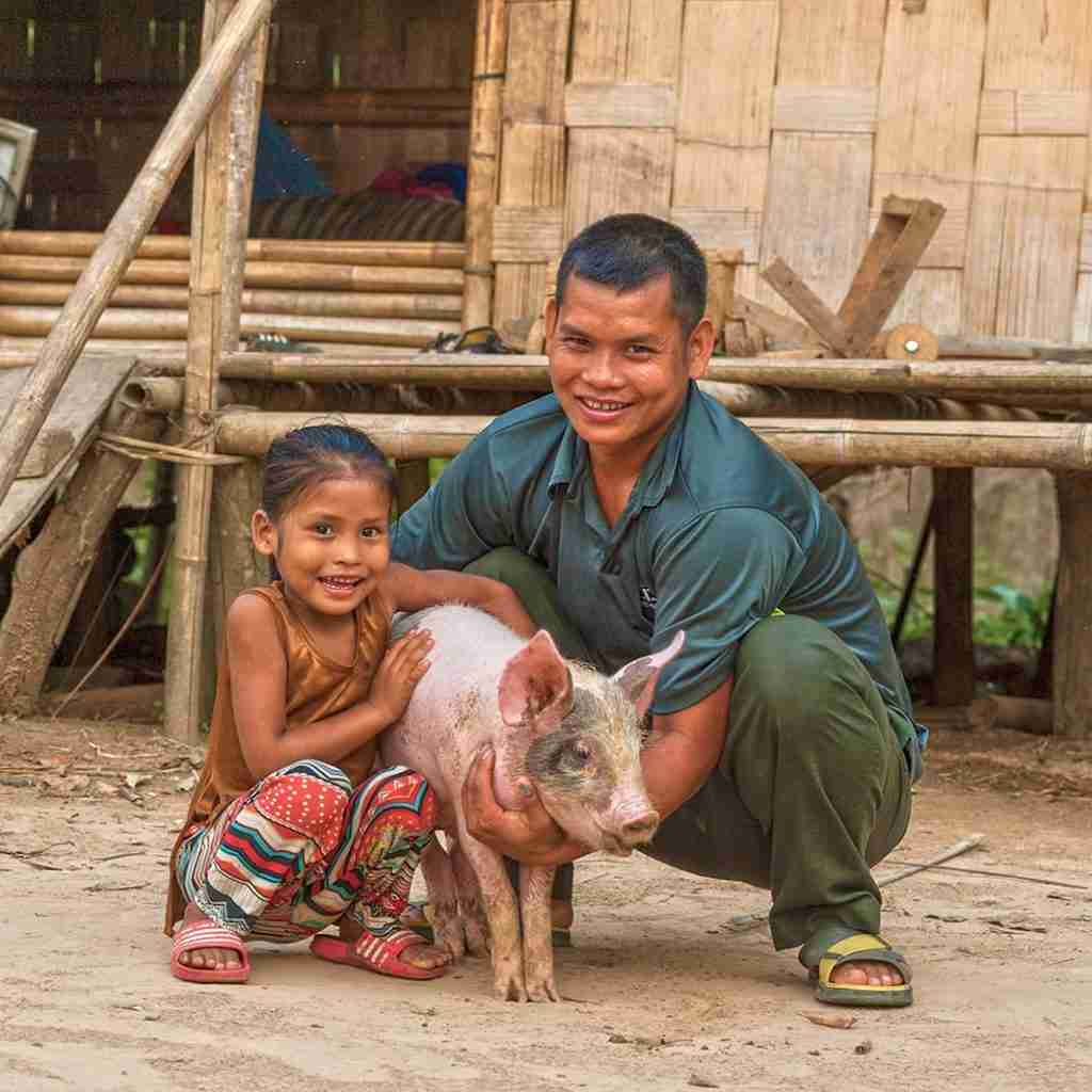 Family receives pig from GFA World Gifts from the Stable