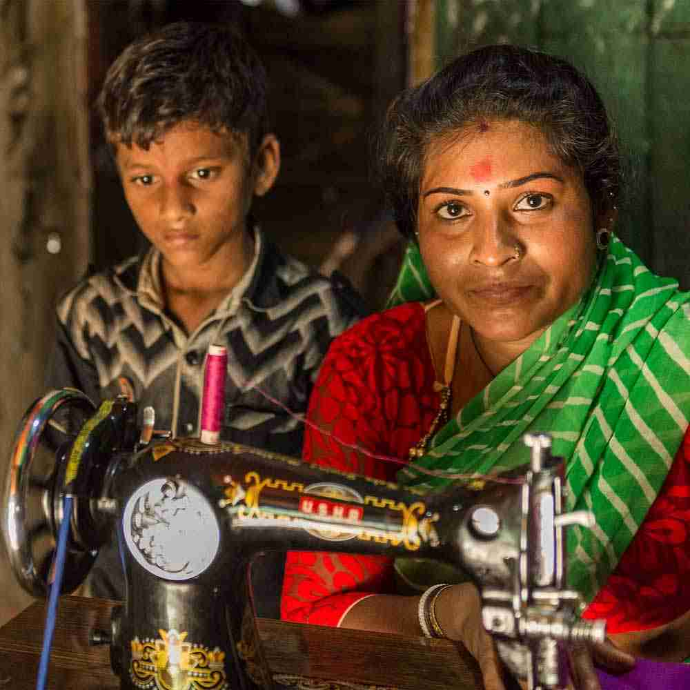 This mother helps provide for her children and family through newly acquired tailoring skills and the gift of a sewing machine.