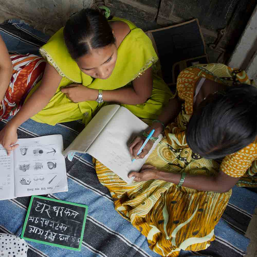 This woman is learning how to read and write from a literacy class