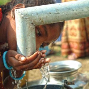 Girl drinking water from Jesus well
